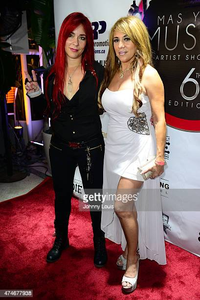 "Liz taylor and Monica Salguero attend the Billboard Latin Music Conference and Awards - day 1 during the ""Mas Y Mas Musica"" Sixth Edition Artist..."