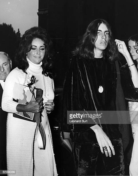 Liz Taylor arriving at Caxton Hall with her son Michael Wilding on the day of his wedding to Beth Clutter