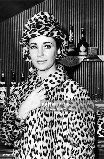 Liz Taylor in leopard skin coat and hat