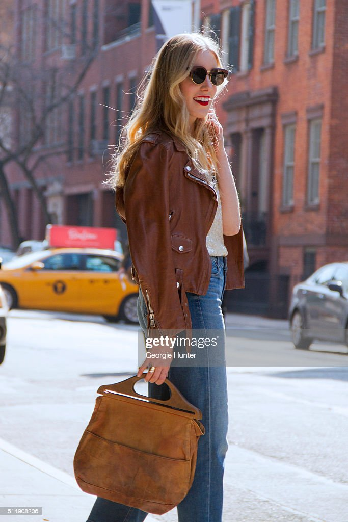 Liz Teich wearing Acne brown leather jacket, gold sequined Chlo top, high waisted Mother Denim jeans, sunglasses by Finlay & Co., vintage brown leather bag and Slate Jewelry bracelet on March 11, 2016 in New York City.