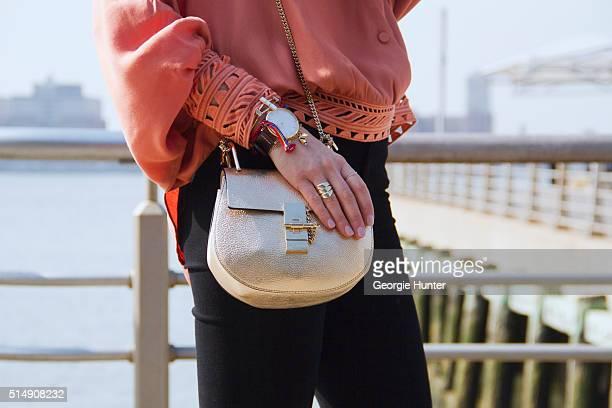 Liz Teich wearing orange Sass Bide top Goldsign black flared pants gold Chlo bag Slate Jewelry bracelet Vestal watch and Dara Senders New York charm...
