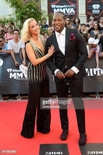 Liz Trinnear and Tyrone Edwards arrive at the 2016 iHeartRADIO MuchMusic Video Awards at MuchMusic HQ on June 19 2016 in Toronto Canada