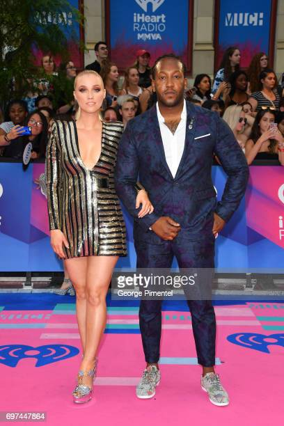 Liz Trinnear and Tyrone Edwards arrive at the 2017 iHeartRADIO MuchMusic Video Awards at MuchMusic HQ on June 18 2017 in Toronto Canada
