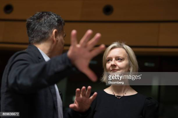 Liz Truss chief secretary to the UK Treasury right stands with Euclid Tsakalotos Greece's finance minister ahead of an Ecofin meeting of European...