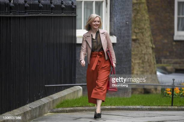 Liz Truss UK international trade secretary arrives for a prebudget meeting of cabinet ministers at number 10 Downing Street in London UK on Wednesday...