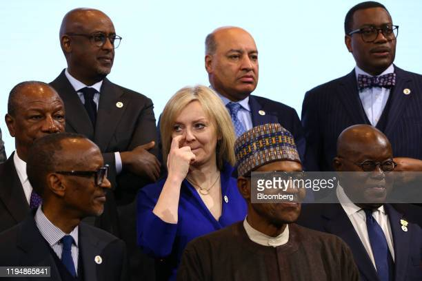 Liz Truss UK international trade secretary center takes part in a family photo with leaders of African countries at the UK Africa Investment Summit...