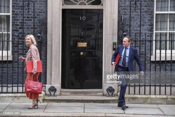 Liz Truss UK international trade secretary left and George Eustice UK environment secretary depart following a prebudget meeting of cabinet ministers...