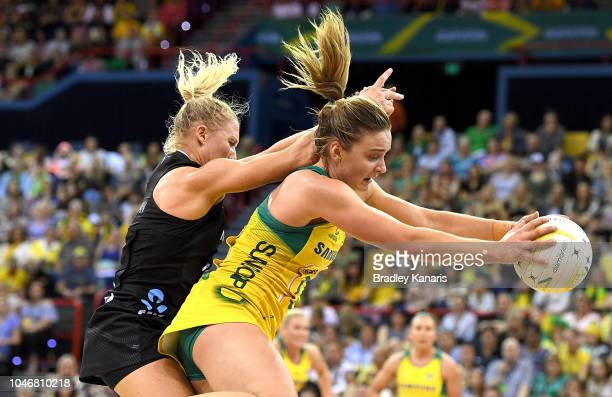 Liz Watson of the Australian Diamonds and Laura Langman of the New Zealand Silver Ferns challenge for the ball during the Constellation Cup match...