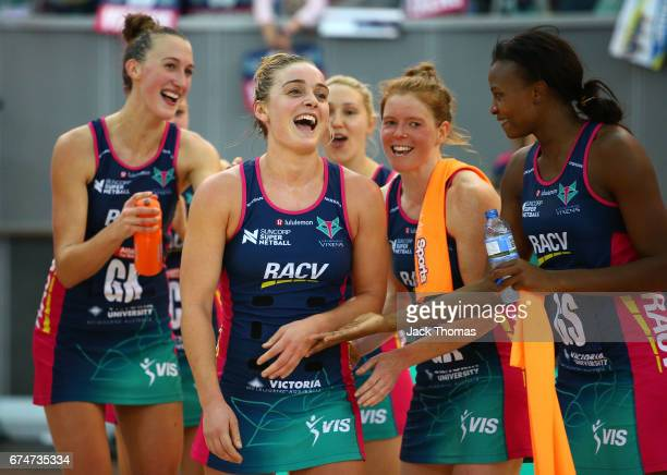 Liz Watson of the Melbourne Vixens during the presentation for reaching the 50 game milestone after the round 10 Super Netball match between the...