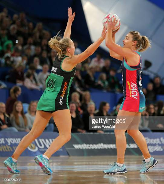 Liz Watson of the Melbourne Vixens looks to pass while under pressure from Jessica Anstiss of the West Coast Fever during the round 13 Super Netball...