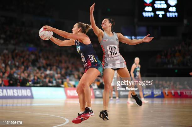 Liz Watson of the Vixens and Ash Brazill of Collingwood compete for the ball during the round 7 Super Netball match between the Vixens and the...