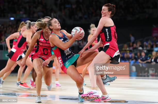 Liz Watson of the Vixens and Kate Shimmin of the Thunderbirds compete for the ball during the round 11 Super Netball match between the Vixens and the...