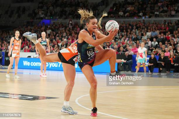 Liz Watson of the Vixens competes for the ball during the round two Super Netball match between the Melbourne Vixens and the Giants at Melbourne...