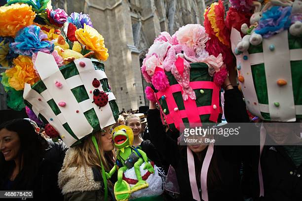 Liz Woram left from New Jersey kisses a Kermit the Frog doll as she makes her way along Fifth Avenue during the annual Easter Parade April 5 2015 in...