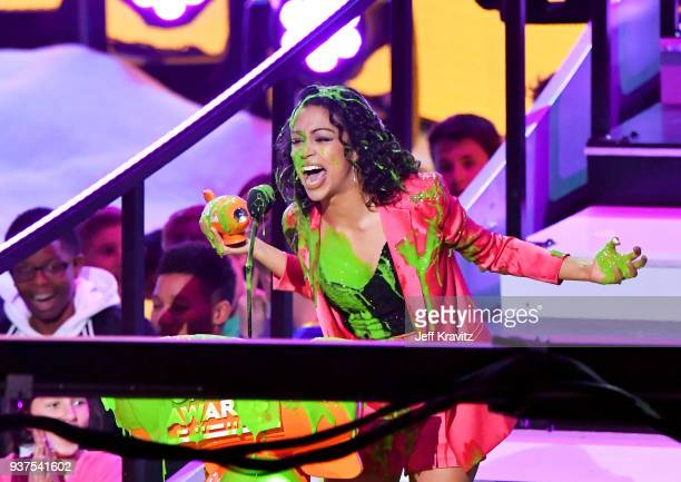 Liza Koshy accepts the Favorite Funny YouTube Creator award onstage at Nickelodeon's 2018 Kids' Choice Awards at The Forum on March 24 2018 in...