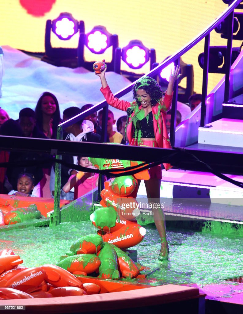 Liza Koshy gets slimed as she accepts Favorite Funny YouTube Creator onstage at Nickelodeon's 2018 Kids' Choice Awards at The Forum on March 24, 2018 in Inglewood, California.