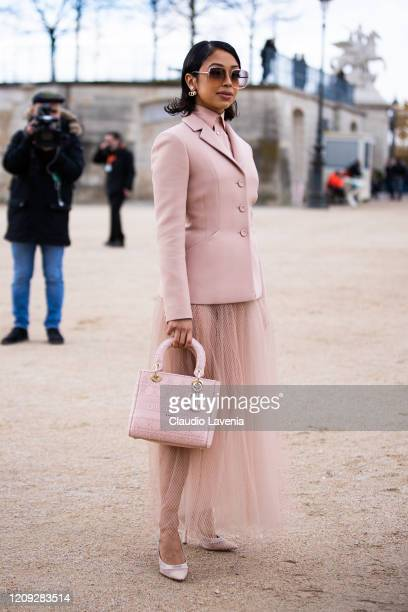 Liza Koshy, wearing a pink blazer, pink shirt, pink tulle maxi skirt, Dior bag and Dior heels, is seen outside Dior, during Paris Fashion Week -...