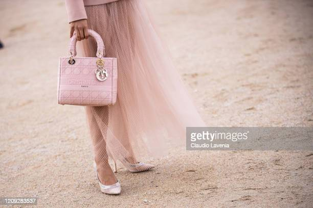 Liza Koshy, wearing a pink blazer, pink tulle maxi skirt, Dior bag and Dior heels, is seen outside Dior, during Paris Fashion Week - Womenswear...