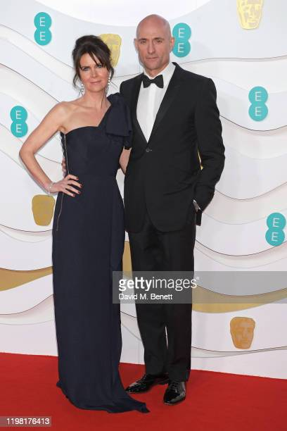 Liza Marshall and Mark Strong arrive at the EE British Academy Film Awards 2020 at Royal Albert Hall on February 2, 2020 in London, England.