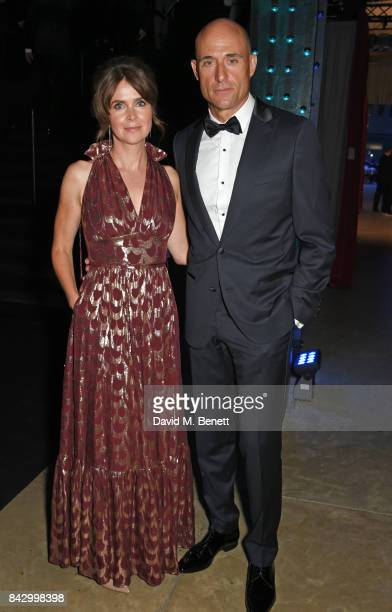 Liza Marshall and Mark Strong attend the GQ Men Of The Year Awards at the Tate Modern on September 5 2017 in London England
