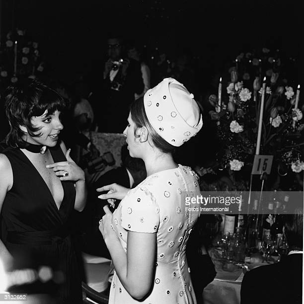 Liza Minnelli and Barbra Streisand, both American singers and actresses, speak at the Academy Awards, Los Angeles, California, April 7, 1970.