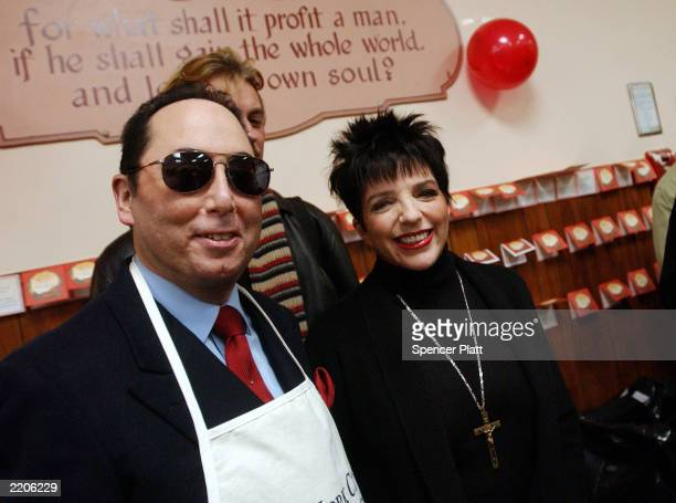 Liza Minnelli and husband David Gest pose after serving food during a Thanksgiving meal at the New York City Rescue Mission at the New York City...