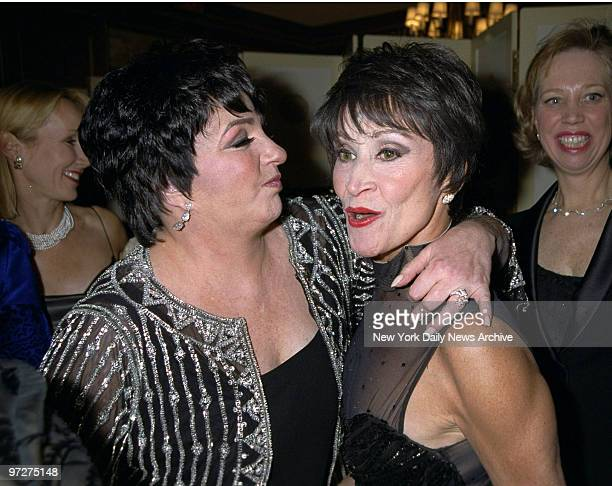 Liza Minnelli gives Chita Rivera a hug at the Drama League's benefit honoring Minnelli at the Pierre Hotel