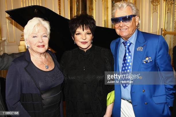 Liza Minnelli is pictured with Line Renaud and Michou before being awarded Officier dans l'Ordre de la Legion d'Honneur by Frederic Mitterrand at...