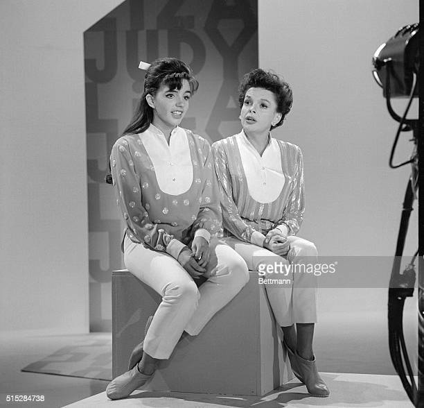 Liza Minnelli is shown with her mother, Judy Garland, as the two rehearse for her mother's new television show , in which Judy and Liza sing and...