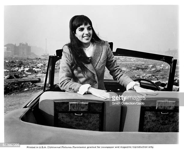Liza Minnelli sitting in a car and smiling during the film Charlie Bubbles, 1967.