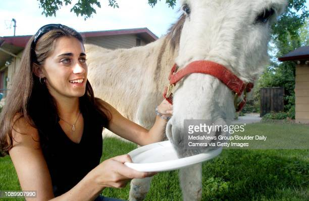 Liza Mitchell senior at Alexander Dawson give her burro Poppy some raisons after he pick up his frisby for her Wednesday evening at her home in...