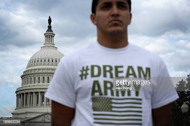 Lizardo Buleje of San Antonio Texas stands in front of the US Capitol during a rally on immigration reform October 23 2013 on Capitol Hill in...