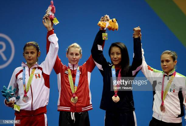 Lizbeth Diez Canseco of Peru Ivett Gonda of Canada Deireanne Estephany Morales of USA and Jannet Alegria of Mexico after the Women's Taekwondo under...