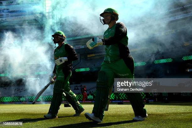 Lizelle Lee and Angela Reakes of the Stars walk out to bat during the Women's Big Bash League between the Melbourne Stars and the Melbourne Renegades...