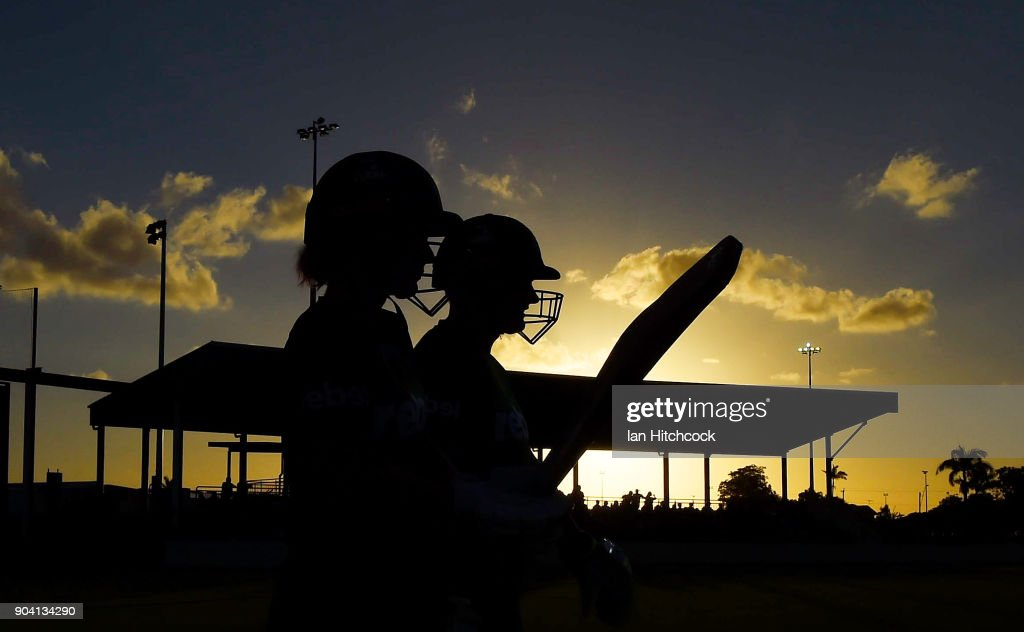 Lizelle Lee and Katie Mack of the Stars walk onto the field during the the Women's Big Bash League match between the Brisbane Heat and the Melbourne Stars at Harrup Park on January 12, 2018 in Mackay, Australia.