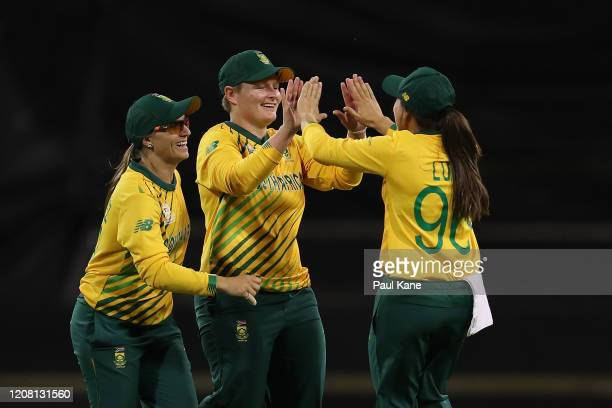 Lizelle Lee and Sune Luus of South Africa celebrate the wicket of Danielle Wyatt of England during the ICC Women's T20 Cricket World Cup match...