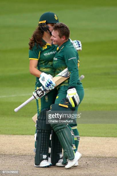 Lizelle Lee of South Africa celebrates her century with team mate Laura Wolvaardt during the ICC Women's Championship 2nd ODI match between England...