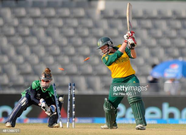 Lizelle Lee of South Africa gets bowled out by Isobel Joyce captain of Ireland during the ICC Women's world twenty20 match between South Africa Women...