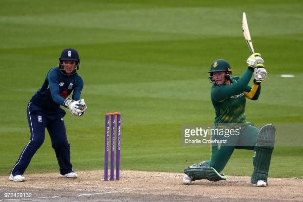 Lizelle Lee of South Africa hits out while Sarah Taylor of England watches on during the ICC Women's Championship 2nd ODI match between England Women...