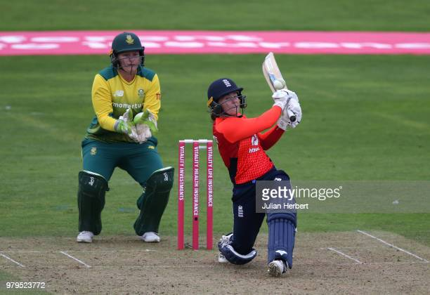 Lizelle Lee of South Africa looks on as Tammy Beaumont of England hits out during the International T20 TriSeries match between England Women and...