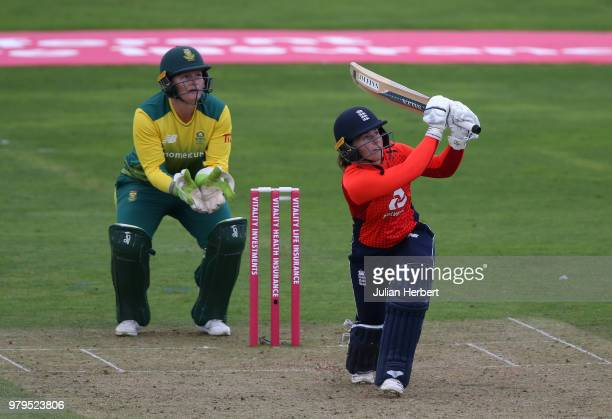 Lizelle Lee of South Africa looks on as Tammy Beaumont of England scores runs during the International T20 TriSeries match between England Women and...