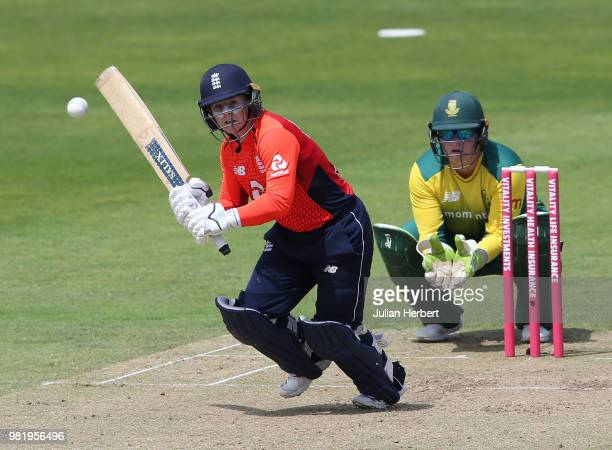 Lizelle Lee of South Africa looks on as Nat Sciver of England scores runs during the International T20 TriSeries match between England Women and...