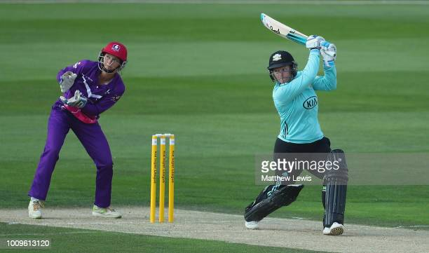 Lizelle Lee of Surrey Stars hits the ball towads the boundary as Amy Jones of Loughborough Lightning looks on during the Kia Super League match...