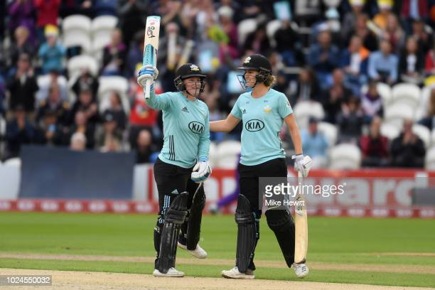 Lizelle Lee of Surrey Stars is congratulated by team mate Natalie Sciver after reaching her century during the Final between Loughborough Lightning...