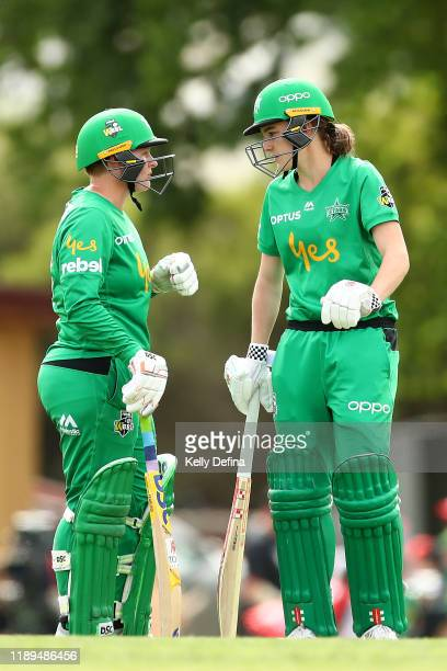 Lizelle Lee of the Stars and Annabel Sutherland of the Stars talk during the Women's Big Bash League match between the Melbourne Renegades and the...