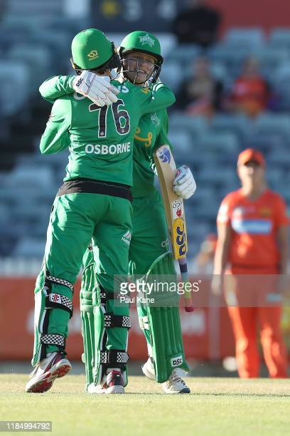 Lizelle Lee of the Stars celebrates her century with Erin Osborne during the Women's Big Bash League match between the Perth Scorchers and Melbourne...