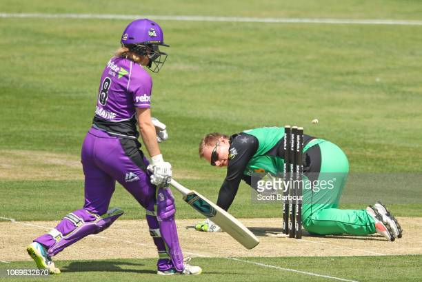Lizelle Lee of the Stars runs out Georgia Redmayne of the Hurricanes during the Women's Big Bash League match between the Hobart Hurricanes and the...