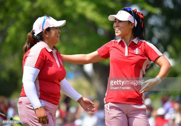 Lizette Salas and Danielle Kang of Team USA celebrate winning their match during the morning foursomes matches of The Solheim Cup at Des Moines Golf...