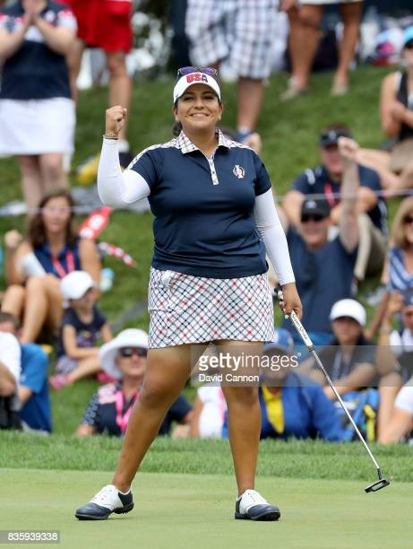 Lizette Salas of the United States team celebrates holing a putt on the 18th hole to win her match against Jodi Ewart Shadoff of the European team...