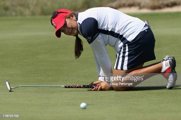 Lizette Salas of the United States Team reacts after missing a putt on the 15th hole as she and teammate Brittany Linciome halved their match with...